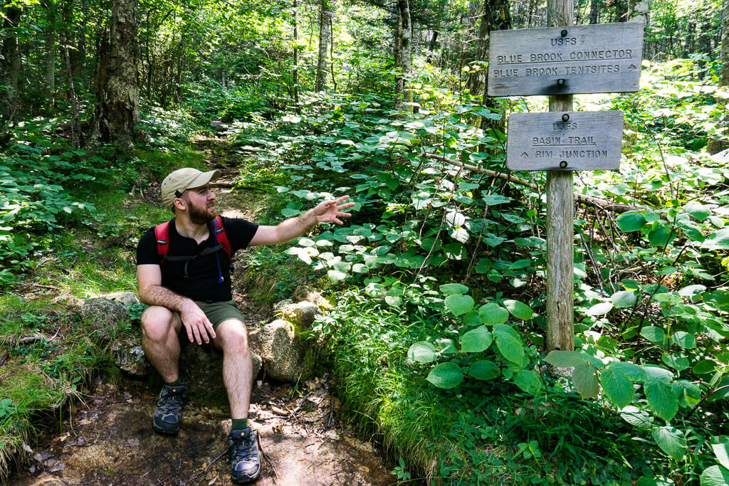 Erich reads trail signs in the white mountains